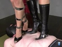 They grind their heels in deeply and enjoy making out a bit as he suffers beneath them!