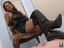 Mistress Giselle becomes aroused as the slut worships her boots.