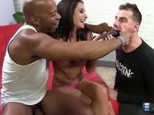 Randi and Shane swap spit while the cuckold helplessly looks on. She gets on her knees and mouth loves that big, black cock.