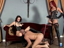 Amadahy orders her bitch to kneel before Tristan and beg to worship her pussy. As his tongue pleasures Tristan, Amadahy mercilessly tortures him.