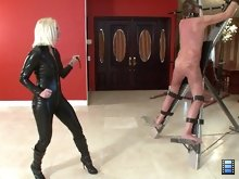 Miss Coral is a sadistic bitch. She enjoys whipping male bitches and watching them suffer. Today, she has a new slut strapped to a cross.