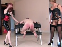 The ladies begin making the trembling slut beg for more cane strokes. Incredibly powerful ladies!