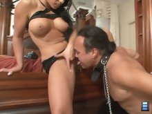 After the stud has shot a huge load in wife's pussy, she puts the cuck on his knees and watches, as he licks her up.
