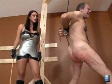 When Megan has had her fill she cuts the slut down and puts him back into his cage.