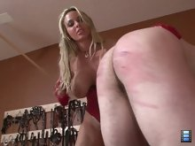 When he begins to whimper and moan, Holly grabs his balls up and squeezes them.