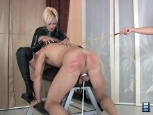With his balls tied down, the slave has no choice but to submit to the caning..
