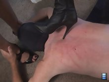 Back and forth their high heels go, leaving skin damage in their wake. The slave groans under the pain but he endures to please his owners.