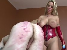 Mistress Holly is in a sadistic mood. She has her slave strapped down and gagged.